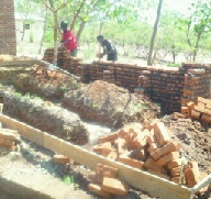 Building new latrines for SOWTech at Namisu